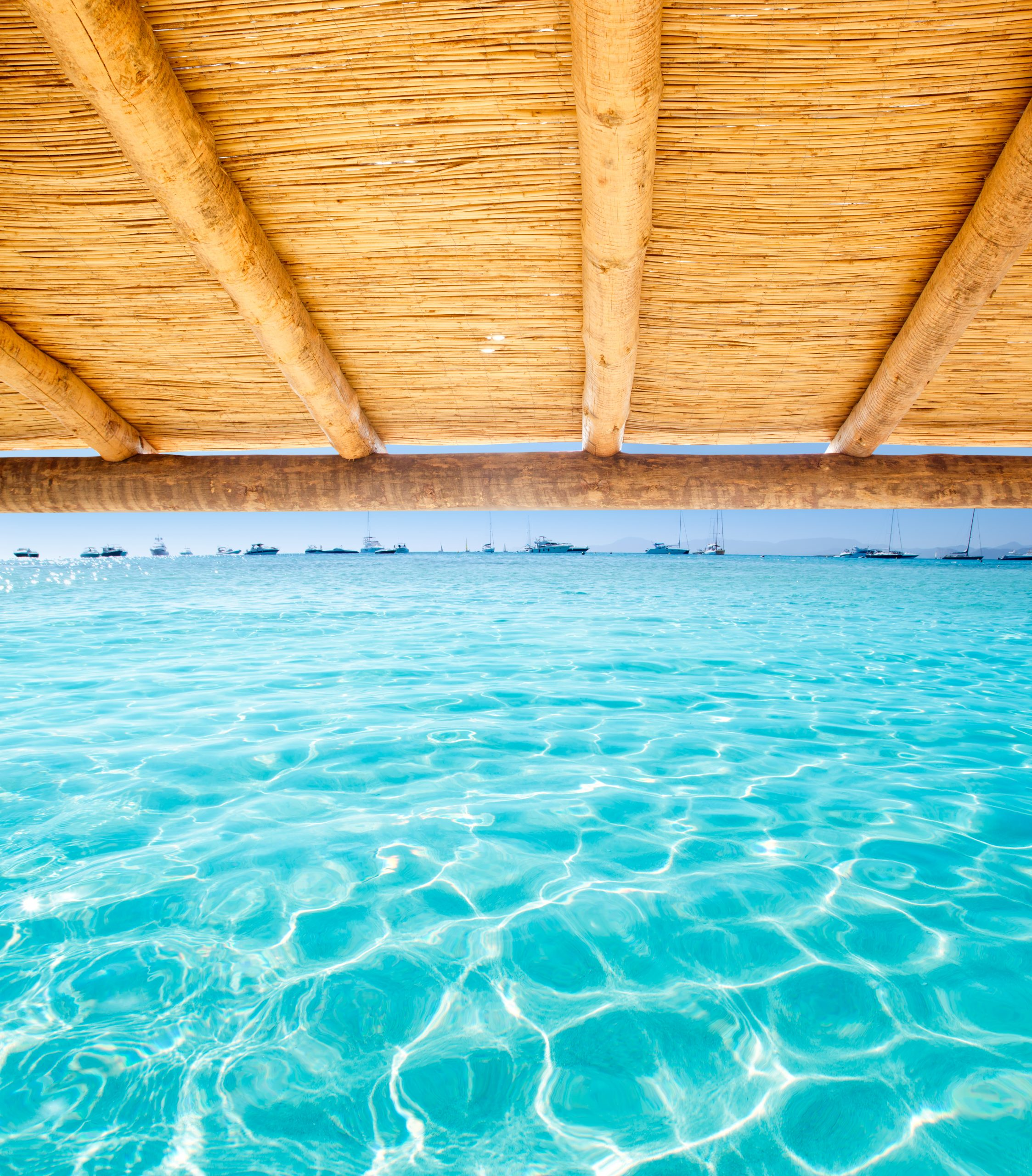 Cane sunroof with tropical perfect beach of Illetes Formentera island